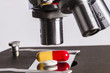 canvas print picture - Science lab research safe of new drugs, microscope and pills