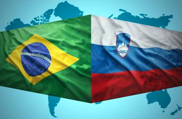 Waving Slovenian and Brazilian flags