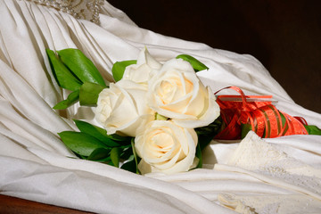 White wedding dress with flowers.