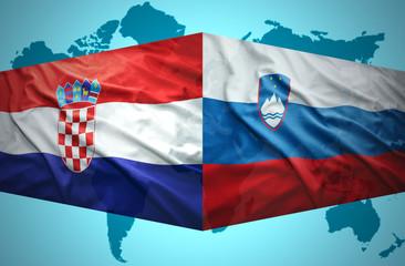 Waving Slovenian and Croatian flags