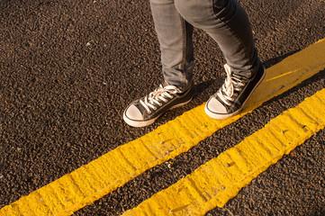 walking on yellow street lines