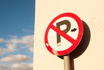 no parking sign wall