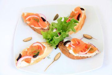 sandwiches with salmon with decoration. Tapas food