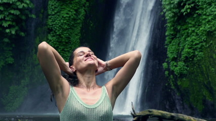 Happy woman touching hair and feeling free, slow motion 240fps