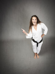 karate athlete indicated with finger empty space