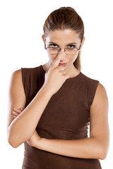 young woman with spectacles with distrust gesture