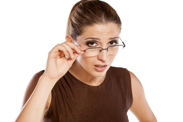 young woman with glasses with a questionable gesture