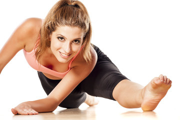 young attractive girl doing yoga exercises