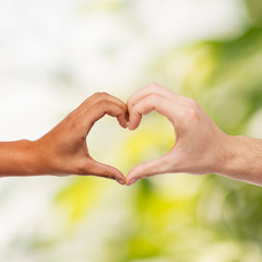 woman and man hands showing heart shape