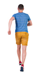 Back view of running man in t-shirt and shorts