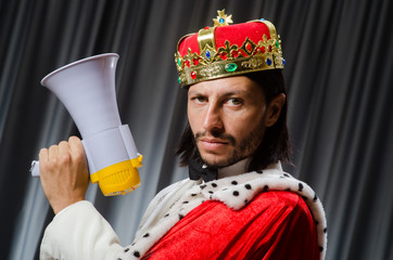 King with loudspeaker in funny concept