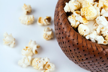 lot of salt popcorn into a bamboo bowl
