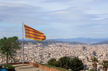 Catalonian flag over Barcelona