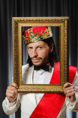 King with picture frame in funny concept