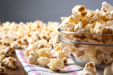 lot of salt popcorn into a bowl