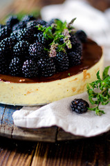 Cheesecake with chocolate and blackberries