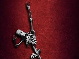 Grunge Halloween background with skeleton