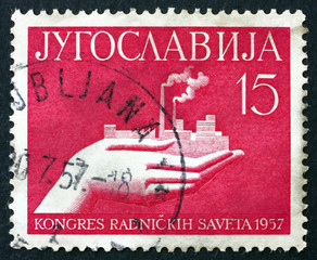 Postage stamp Yugoslavia 1957 Hand Holding Factory