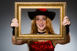 Woman pirate with picture frame