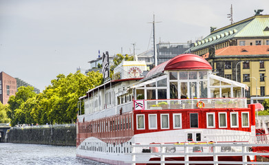 BRATISLAVA, SLOVAKIA - JUNE 24, 2011: Red cruise ship anchored o