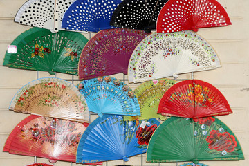 Colorful fans at a street market in Seville, Andalusia, Spain
