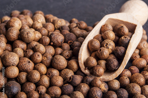 canvas print picture Wooden shovel with  Allspice (jamaica pepper)