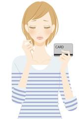 困る カードを持つ女性