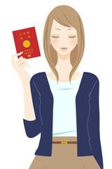 パスポートを持った笑顔の女性