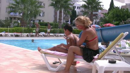 Woman Applying Suntan Lotion