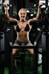 Muscular Woman Doing Heavy Weight Exercise For Biceps