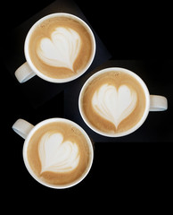 Cup of art cappuccino coffee heart symbol