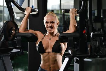 Woman Bodybuilder Doing Exercise For Biceps