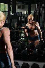 Female Bodybuilder Doing Heavy Weight Exercise For Biceps
