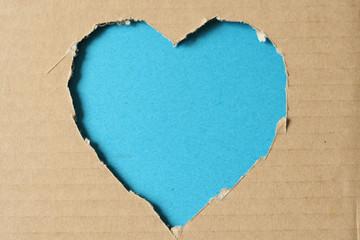 Grunge heart on ragged cardboard background