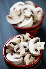 Close-up of fresh raw champignons, vertical shot