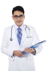 Asian doctor holding medical document
