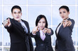 Businesspeople pointing at you