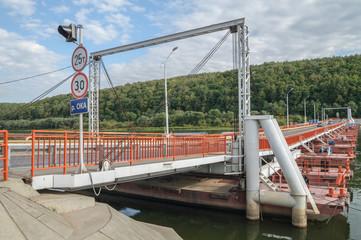 Pontoon bridge across the river in the summer