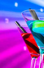 blue and red cocktail with sparkling disco ball background