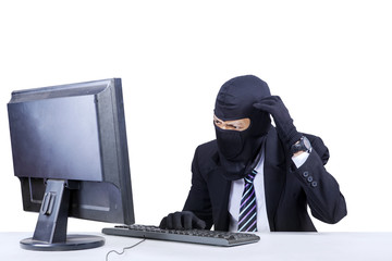 Confused hacker in business suit