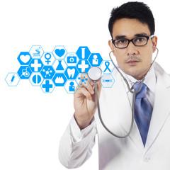 Doctor pressing virtual screen