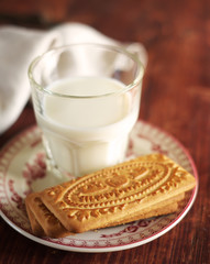 Assorted cookies with a glass of milk