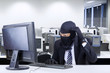 Hacker in business suit getting confused