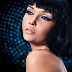 glamour woman with a  fashion bright makeup of eyes