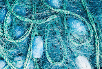 Close view of some blue fishing net floaters