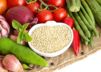Raw organic quinoa and vegetables