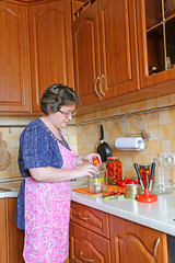 Woman housewife engaged in canning vegetables