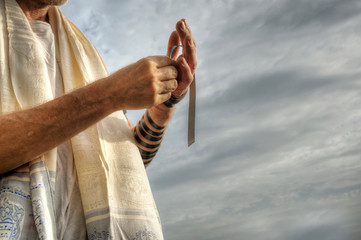 Jewish man preparing for morning prayers.