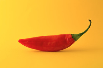 Red chili pepper isolated on a yellow