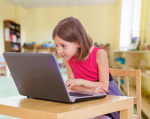 Little girl with laptop great surprise.